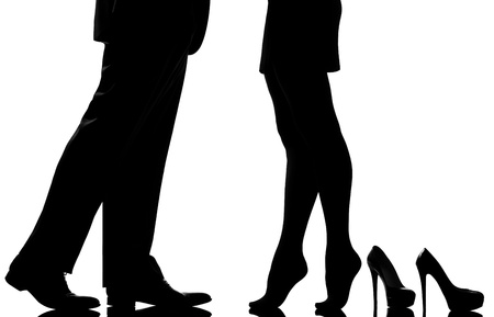 one caucasian detail legs feet couple man and woman tiptoe lovers teenderness in studio silhouette isolated on white background Stock Photo - 11605275