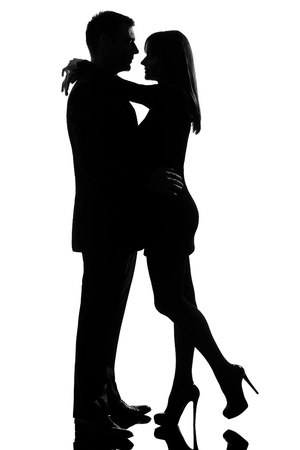 flirting: one caucasian lovers couple man and woman hugging tenderness in studio silhouette isolated on white background