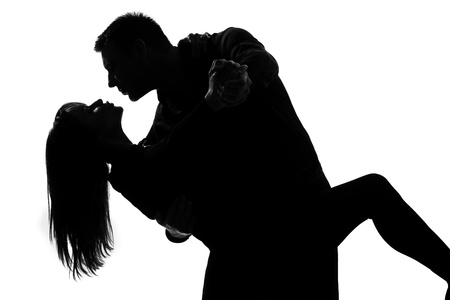one caucasian couple lovers  man and woman dancing tango in studio silhouette isolated on white background photo