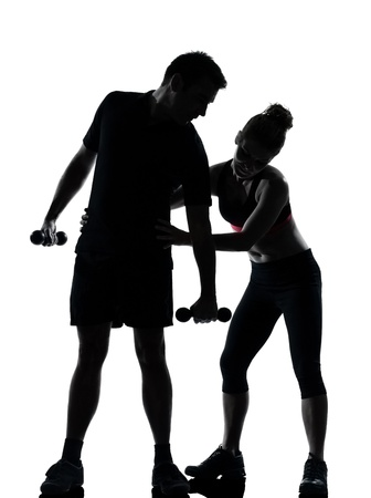 one couple man woman exercising workout aerobic fitness posture full length silouhette on studio isolated on white background Stock Photo - 11632978