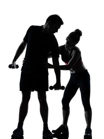 Une femme homme couple exercice d'entraînement aérobique posture longueur silouhette complète en studio isolé sur fond blanc Banque d'images - 11632978