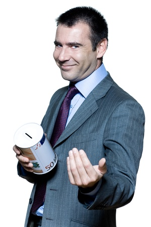 devious: portrait on isolated white background of a smiling  businessman holding a moneybox begging for money Stock Photo