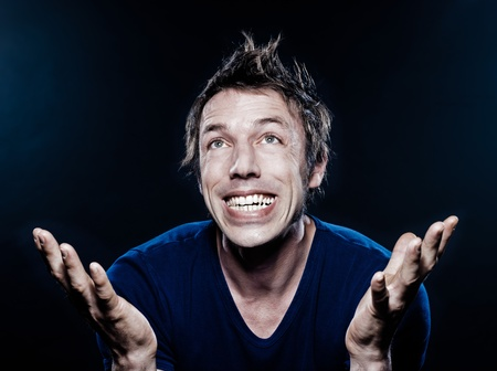 studio portrait on black background of a funny expressive caucasian man ecstatic Stock Photo - 11633762