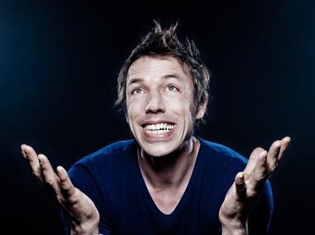 studio portrait on black background of a funny expressive caucasian man ecstatic Stock Photo - 11633762