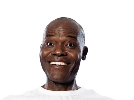 expressing: Portrait of an expressing happy Afro American man smiling in studio on white isolated background