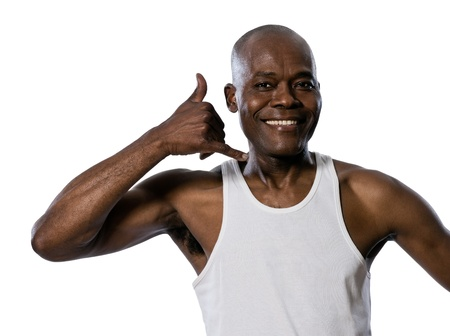 call me: Portrait of a friendly afro American man showing call me gesture in studio on white isolated background Stock Photo