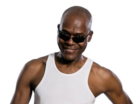 Portrait of an afro American man looking through sunglasses in studio on white isolated background photo