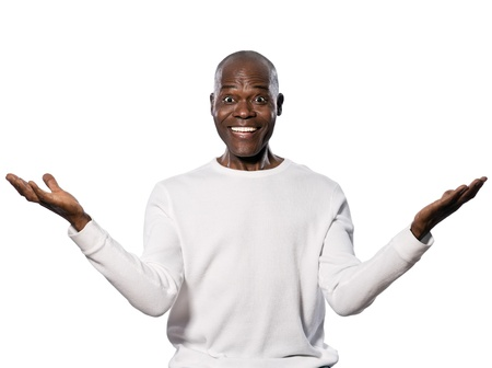amazed: Portrait of an excited afro American man with eyes wide open smiling in studio on white isolated background Stock Photo