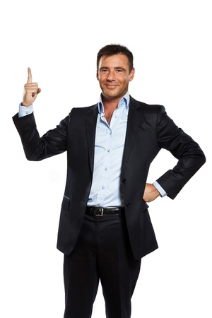 presenting: one caucasian business man pointing up finger blank copy space in studio isolated on white background