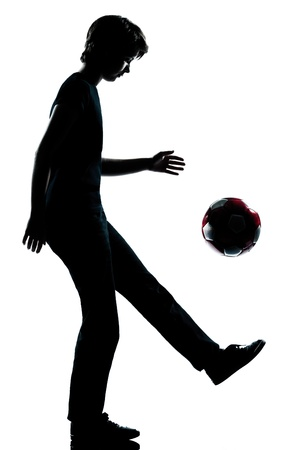 one caucasian young teenager silhouette boy girl  juggling soccer football full length in studio cut out isolated on white background photo