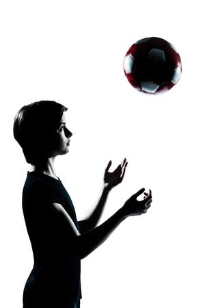 one caucasian young teenager silhouette boy girl tossing soccer football portrait in studio cut out isolated on white background Stock Photo - 11766378