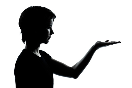 one caucasian young teenager silhouette boy or girl empty hands open portrait in studio cut out isolated on white background photo