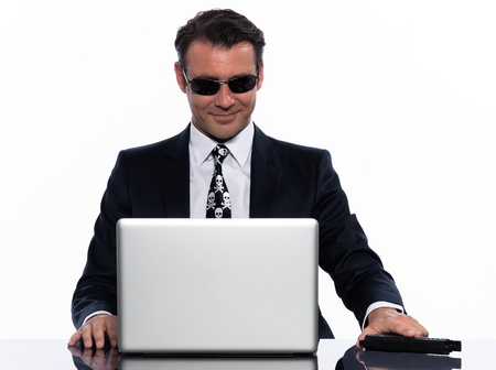 one man criminal hacker caucasian computer hacking computer laptop isolated studio on white background photo