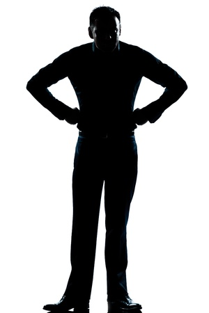 displeased businessman: one caucasian man angry hands on hips full length silhouette in studio isolated white background Stock Photo