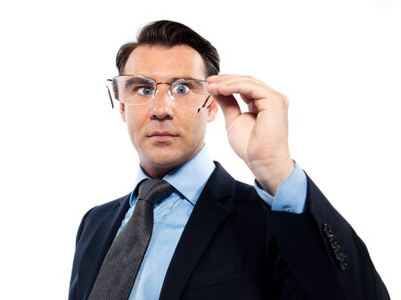squinting: man businessman nearsighted squinting holding glasses isolated studio on white background
