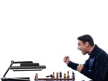 caucasian man playing chess with computer defeat concept on isolated white background photo