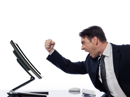 upset man: caucasian man and a computer display monitor on isolated white background expressing  bug  conflict rejection concept