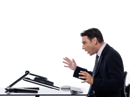 relationship between a caucasian man and a computer display monitor on isolated white background expressing breakdown surprise concept photo