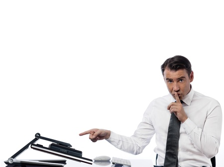 hushing: one  caucasian man computing computer display monitor hushing expressing secrecy concept on studio isolated white background