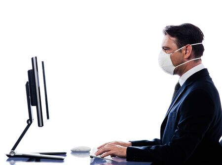 caucasian man cumputing computer wearing protection mask concept isolated studio on white background photo