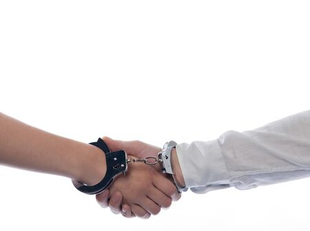 handshake with handcuffs concept agreement isolated studio on white background photo