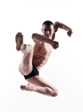 caucasian man gymnastic karate leap isolated studio on white background Stock Photo - 11766445