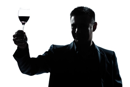 one caucasian man portrait silhouette rising up toasting his glass of red wine in studio isolated white background Фото со стока