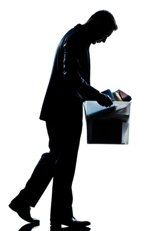 one caucasian man walking  full length fired carrying heavy box silhouette in studio isolated white background Stock Photo - 11749148