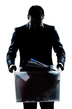 one caucasian man portrait silhouette carrying heavy box in studio isolated white background photo