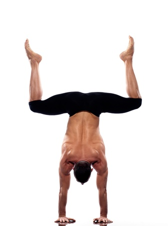 one caucasian man yoga handstand gymnastic acrobatics full length studio isolated on white background Stock Photo - 11633119