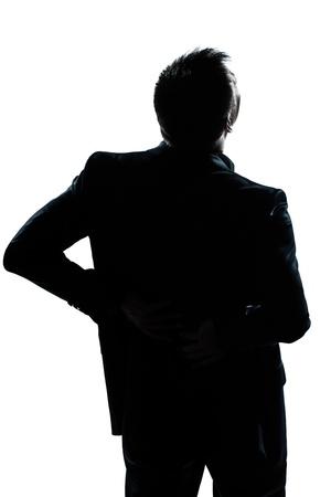 back shots: one caucasian man portrait silhouette backache in studio isolated white background