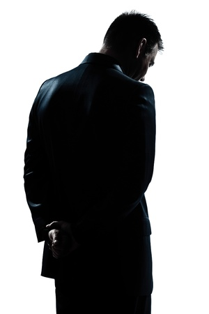 one caucasian man portrait silhouette backside sad despair lonely in studio isolated white background photo
