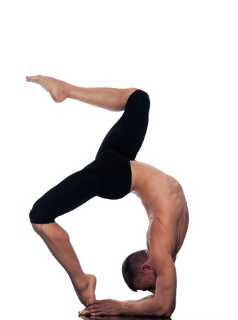caucasian man Eka Pada Viparita Dandasana One-legged Inverted Staff  pose stretch acrobatics yoga balance posture isolated studio on white background photo