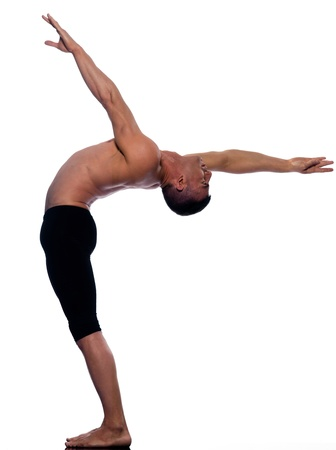 bending: caucasian man gymnastic stretching balance isolated studio on white background