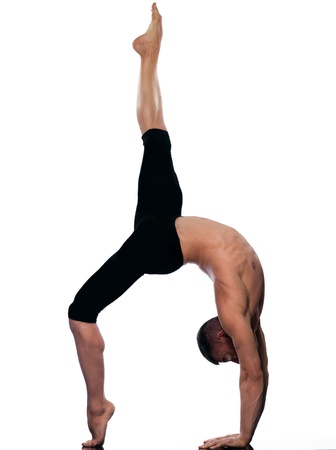 flexible: caucasian man gymnastic stretching acrobatics isolated studio on white background