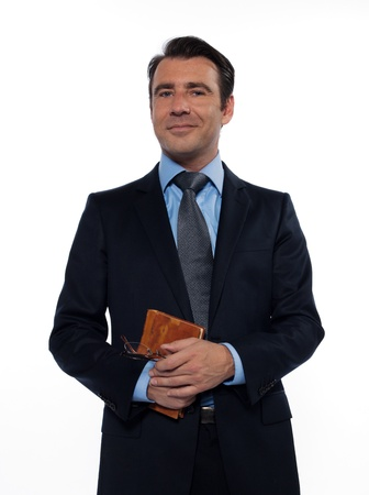 business attire teacher: one businessman man caucasian teacher professor holding book smiling looking at camera isolated studio on white background
