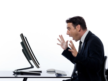 one caucasian business man  computing and a computer display monitor on isolated white background Stock Photo - 11752899