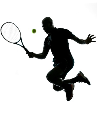 african american silhouette: man african afro american playing tennis player forehand on studio isolated on white background Stock Photo