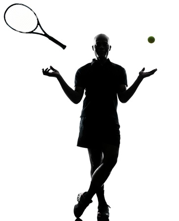 one african afro american man tennis player full length standing throwing ball and racket silhouette on studio isolated on white background photo