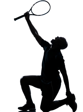 vanquish: on man african afro american playing tennis player kneeling screaming on studio isolated on white background