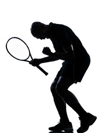 african american silhouette: man african afro american playing tennis player man tennis player victory sucess happy screaming on studio isolated on white background Stock Photo