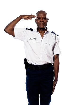 Portrait of an afro American police officer saluting in studio on white isolated background photo