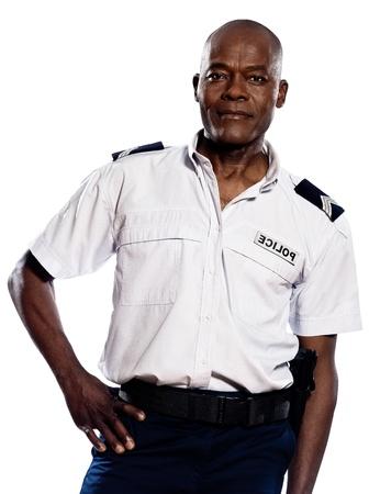 アフロアメリカン: 白い背景と分離スタジオで腰に手でアフロ アメリカ人警官の肖像画 写真素材