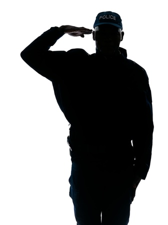 salute: Silhouette one policeman saluting in studio on white isolated background Stock Photo