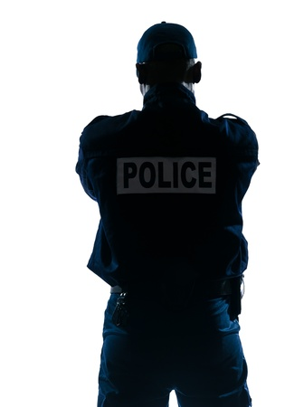 Rear view of an afro American police officer standing isolated on white isolated background photo