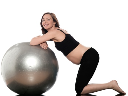 pregnant caucasian woman swiss ball fitness isolated studio on white background Stock Photo - 11765066