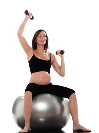 pregnant woman yoga: one Pregnant Woman Workout weight training pilates sitting on swiss ball isolated studio on white background Stock Photo