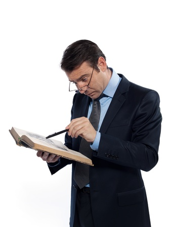 one man caucasian professor teacher teaching  reading an ancient book isolated studio on white background photo