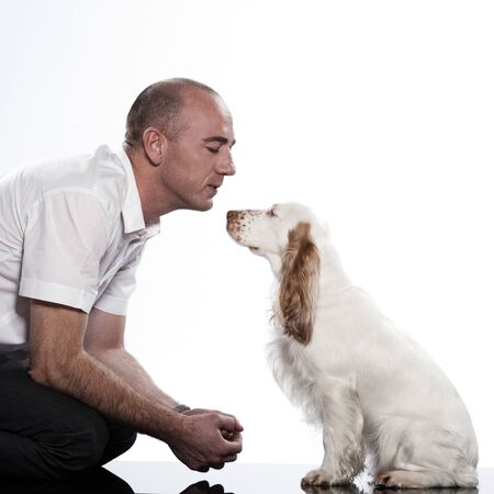 red English Cocker Spaniel and his master on studio white background Stock Photo - 11766476