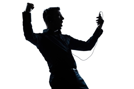 one caucasian man happy listening to music portrait silhouette in studio isolated white background photo